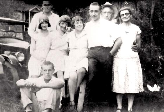 Russ Larson, Sig Larson, Carl Roning (seated), Mabel Roning, Babe Roning, Cliff Roning, Grandpa, Ma