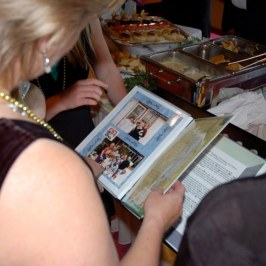 Janice looking through memory book