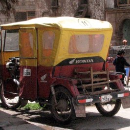 Small 3-wheel Hondas are used as taxis in the small villages.
