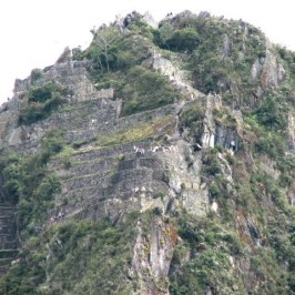 The telephoto shot of the top of Huayna Picchu shows numerous climbers.