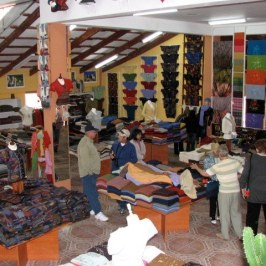 A store featuring finely woven textiles and clothing.